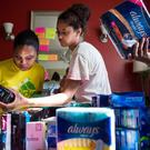 SOLUTION: Sorting through products donated to combat period poverty in the United States. Picture: Getty