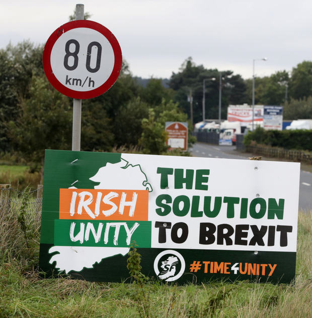 Division: An anti-Brexit pro-Irish unity billboard on the Border between Newry and Dundalk. Photo: Getty Images