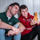 EMPATHY: Dublin footballer and Concern ambassador Michael Darragh MacAuley was keen to meet refugees who had fled to Iraq from Syria, especially young people whose entire lives have been consumed by the almost decade-long conflict. Here, some of the children pose for a selfie with the Dubs star. Picture: Gavin Douglas/Concern