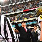 Self-interest: Donald Trump tosses the coin before the Army v. Navy football game in Philadelphia on Saturday. Photo: Andrew Caballero-Reynolds / AFP via Getty