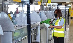Flying restart: A staff member uses an electrostatic sprayer to dispense disinfectant at check-in at Dublin Airport. Photo: Colin Keegan/Collins Dublin