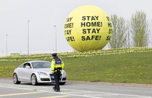 BEST STAY HOME: Garda checkpoint on the Johnstown Road, Naas, with a new message on the Naas Ball in the background, as people are urged not to travel because of the coronavirus crisis. Photo: Tony Gavin