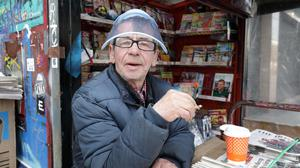 Open for business: Newspaper vendor Francis Mumbley from Stonybatter, Dublin, at work on his stall in O'Connell Street, Dublin. Photo: Frank McGrath