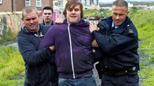 Fran (Peter Coonan) is led away by gardai in this scene from last night's Love/Hate.