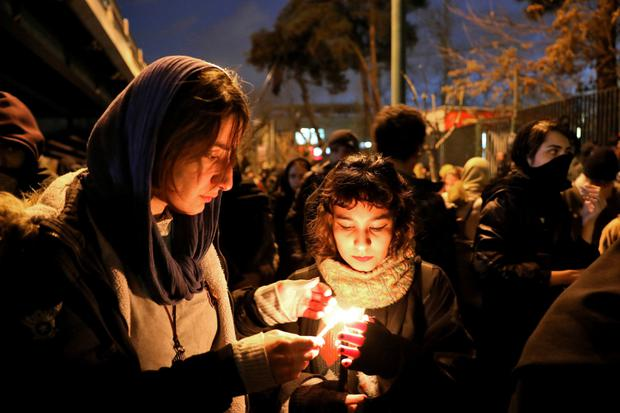 Candlelit vigil: People gather to remember the victims of Flight 752 at Amri Kabir University, Tehran, where some victims had been students. Photo: AP