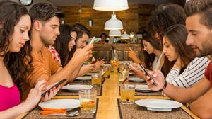 Bad example to children: Social media enables us to join up and be collectively horrible together, like a tsunami of bullies that rolls on and on. Stock photo