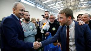 Winners: Sinn Féin's Donnchadh Ó Laoghaire and Fianna Fáil leader Micheál Martin, who took the top two places in Cork South-Central. Photo: Henry Nicholls/Reuters
