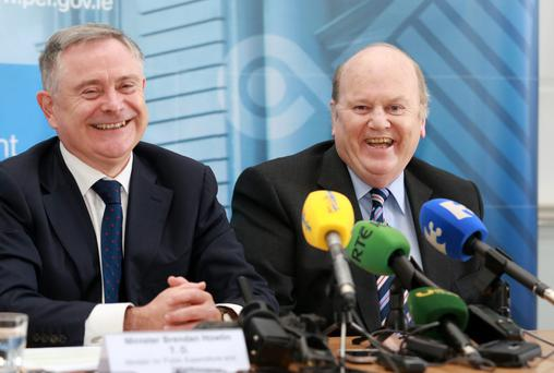 Minister for Finance Michael Noonan and Brendan Howlin, Minister for Public Expenditure and Reform pictured during the presentation of the latest Exchequer Returns at the Dept of Finance