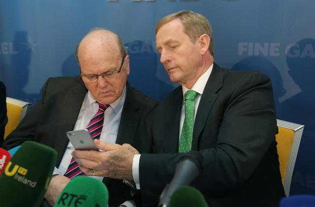 DOING THEIR SUMS: Ultimately, Michael Noonan and Enda Kenny will do whatever they deem to be to Fine Gael's benefit— and Labour can just lump it