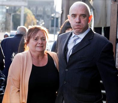 Antoinette McLoughlin pictured leaving the Four Courts with her husband, Michael (right), after her case