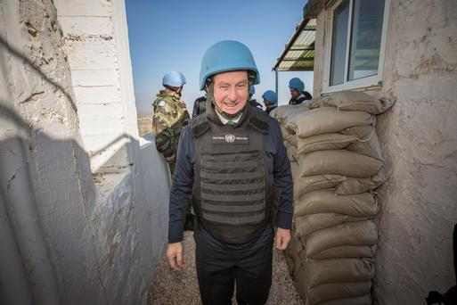 OUR BOYS: Enda Kenny at Camp Ziouani, Golan Heights, visiting Irish peacekeeping troops at Christmas. Photo: Mark Condren