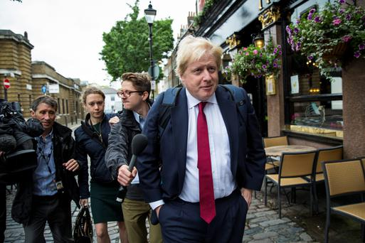 RESULT: Former London Mayor Boris Johnson is questioned by journalists near his home last week. GETTY