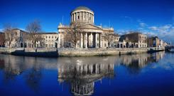 CASE SENSITIVE: The Four Courts building in Dublin and, inset, Chief Justice Susan Denham, who lauded her colleagues in a 'gushing' speech last weekend. Dan O'Brien wonders if judicial egos have become unusually fragile and asks if the deference of society and the media towards the judiciary has made judges believe they are above criticism