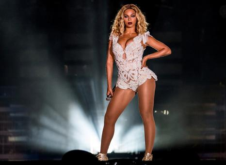 Even Beyoncé, the ultimate marketeer, is in on the act with an illuminated backdrop of the word 'feminist' behind her on stage. Photo: Getty