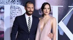 Jamie Dornan, left, and Dakota Johnson arrive at the Los Angeles premiere of 'Fifty Shades Darker' at The Theatre at Ace Hotel. Photo: Jordan Strauss/Invision/AP
