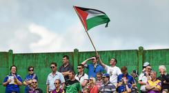 Out of place: A spectator flies a Palestinian flag during the Munster hurling game at Semple Stadium, Thurles. Photo: Sportsfile