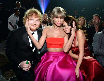 Look: Taylor Swift (middle) with Ed Sheeran and Selena Gomez. Photo: Kevin Mazur