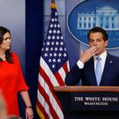 Kissing you already: New White House Communications Director Anthony Scaramucci, flanked by White House Press Secretary Sarah Sanders, blows a kiss to reporters after the daily briefing. Photo: Reuters