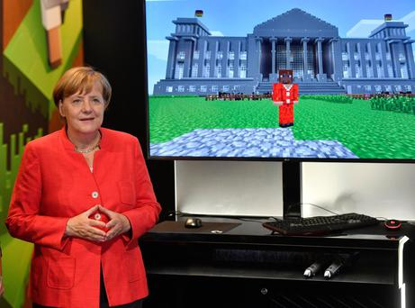 Leading player: Angela Merkel at a computer games fair in Cologne this week. The German Chancellor is likely to be re-elected in the general election on September 24, a victory which could have a significant impact on Ireland's position within the EU Photo: AP Photo/Martin Meissner