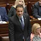 Stand up for your beliefs: Leo Varadkar wearing a shamrock poppy in the Dáil this week