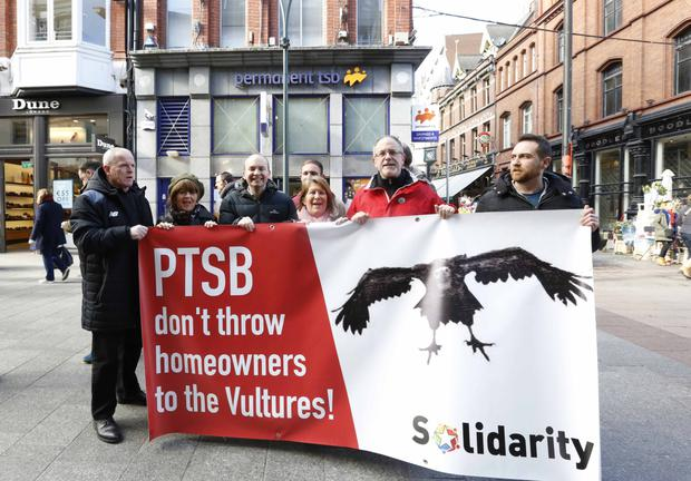 BUILDING ANGER: Solidarity TDs Mick Barry and Paul Murphy join activists at a demonstration outside a Permanent TSB branch in Dublin in protest at plans to sell off 18,000 home loans. Photo: RollingNews.ie