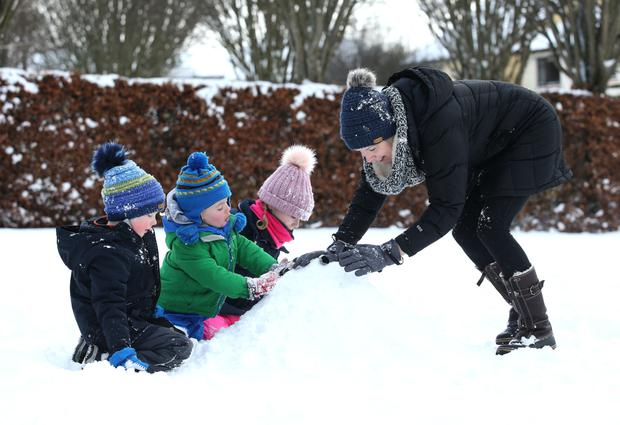 Ethan Gray, Tom Eagers, 2, Olivia Gray, 7 and Caroline Gray, enjoying the snow in Rathcoole, Co. Dublin. Picture credit; Damien Eager