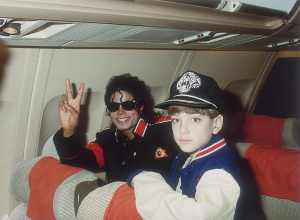 Michael Jackson with 10-year-old James Safechuck on his tour plane in 1988. Photo: Getty