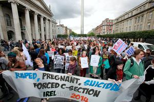 Pro Choice supporters hold a protest on O'Connell Street calling on the Government to repeal the 8th amendment