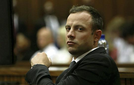 Oscar Pistorius at Pretoria High Court where he stands accused of the murder of his girlfriend Reeva Steenkamp.
