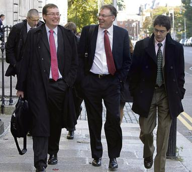 EXIT: IMF mission chief Craig Beaumont, centre, Peter Breuer, left, and other officials leaving the Department of Finance