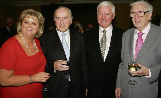 Former Rehab chief executive Angela Kerins (L) and Frank Flannery (second from right) with former taoisigh Albert Reynolds and Garret FitzGerald in 2006. Kerins and Flannery are due to appear before the PAC tomorrow but have not yet indicated whether or not they will attend.