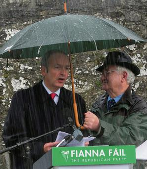 WILL SINN FEIN RAIN ON HIS PARADE? Fianna Fail leader Micheal Martin with Sean Sherwin at the Wolfe Tone commemoration in Bodenstown. Photo: Gareth Chaney Collins