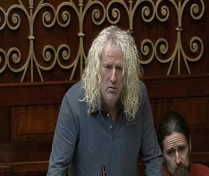 Deputy Mick Wallace takes aim at Minister Shatter during yesterday's Dail session.