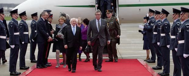 Michael D Higgins is greeted by Viscount Hood on behalf of the Queen on his arrival in London.