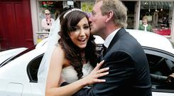 Taoiseach Enda Kenny kisses bride Maria Ryan