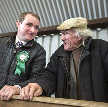 Cahir candidate Martin Lonergan with farmer Vincent O'Donnell at New Inn in Co Tipperary. Photo: John D Kelly
