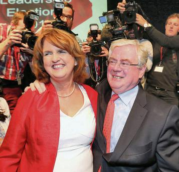 Joan Burton and Eamon Gilmore celebrate at the Mansion House in Dublin yesterday. Collins