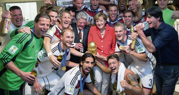 Angela Merkel with the German team
