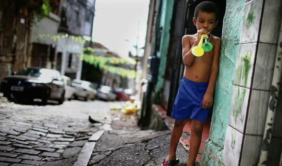 A young Brazil fan stands on the streets of Salvador ahead of last night's Brazil-Mexico game