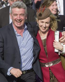 CONVICTIONS: Michael O'Leary, who derided the bogus art of consultancy as far back as 2005, pictured with his wife, Anita, celebrating their win at the JCB Triumph Hurdle race at Cheltenham. Photo: Mark Condren