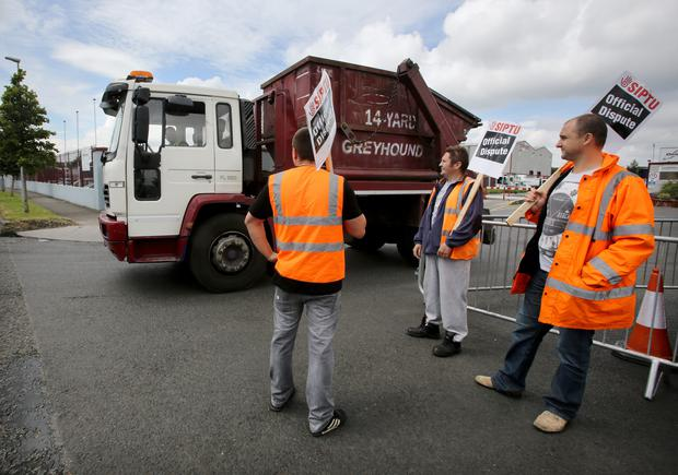 Striking SIPTU workers on the picket line outside the Greyhound household waste depot on Crag Avenue in Clondalkin. Photo: Frank McGrath