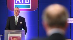 NO APOLOGIES: Deputy Shane Ross speaks to AIB chairman Richard Pym at last week's AGM. Photo: Damien Eagers