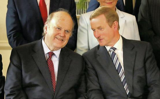 Taoiseach Enda Kenny pictured with Minister for Finance in Aras an Uachtarain after the new ministers were presented with their seals of office