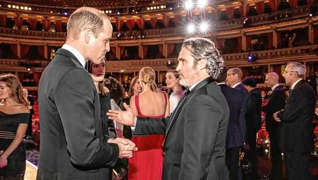 Conflicted: Prince William with activist and frequent flyer Joaquin Phoenix. Photo: Jeff Gilbert/Getty