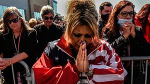 Prayers of the faithful: Daniela Taormina during a pro-Trump rally in New York after it emerged the US president was being treated for Covid-19