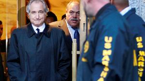 The disgraced late financier Bernie Madoff, pictured here leaving court in Manhattan in 2009, was jailed for 150 years. Picture by Kathy Willens/AP