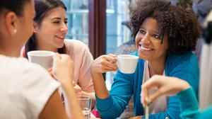 We're all delighted to be able to have coffee with friends again. Stock image.