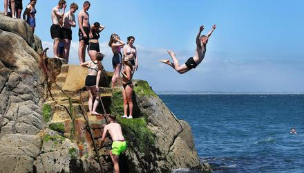 Sunseekers make the most at the Forty Foot in Sandycove, Co Dublin, during the hot weather. Picture by Steve Humphreys