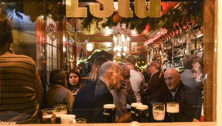 People enjoy a pre-Covid drink and chat in The Long Hall pub in Dublin city centre. Photo: Artur Widak/NurPhoto Getty Images