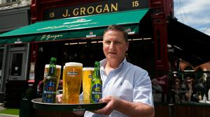 Barman Karl Bradshaw at Grogan's pub in Dublin following the easing of restrictions. Picture by Gareth Chaney/Collins